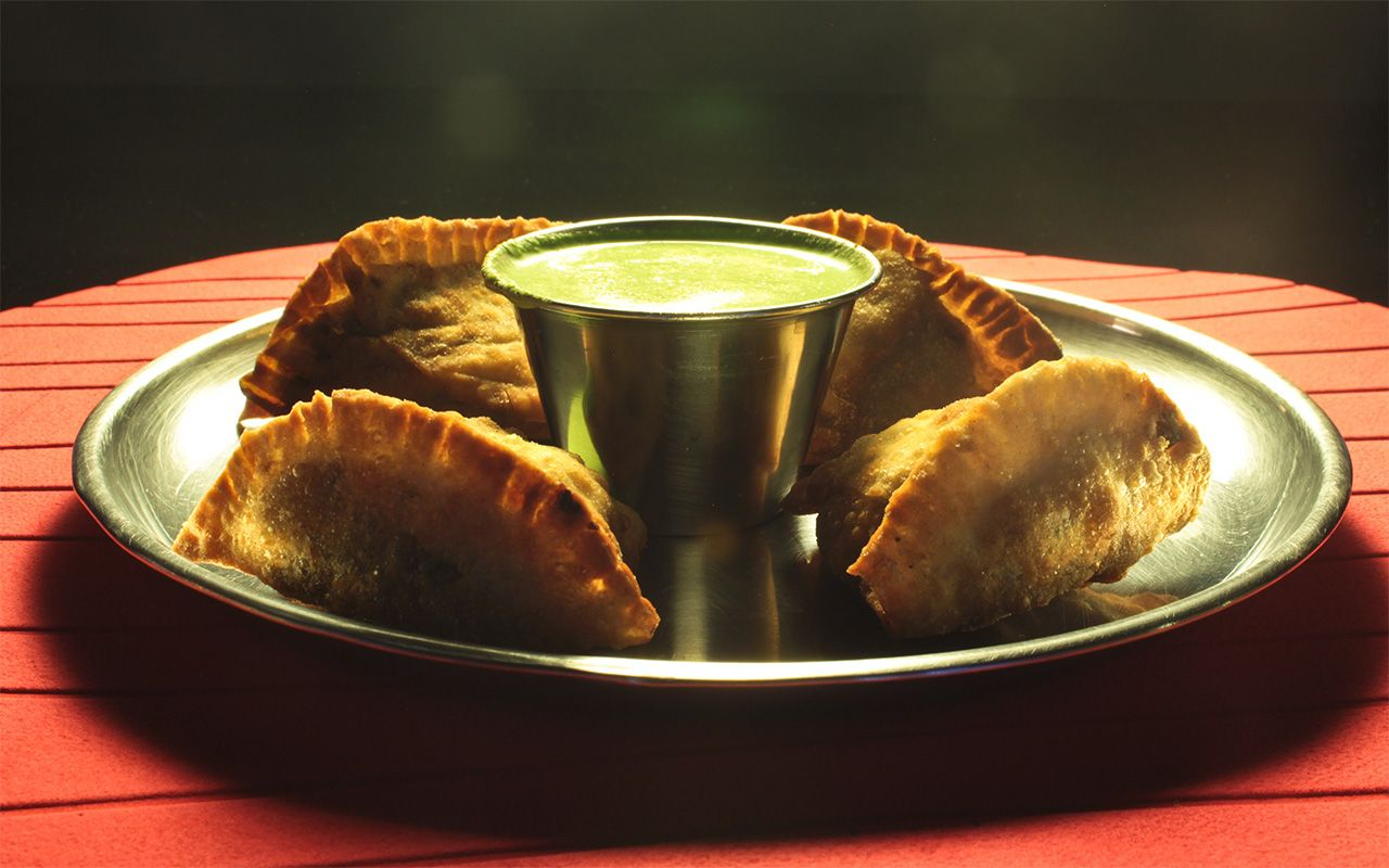 Samosas with mint cilantro chutney